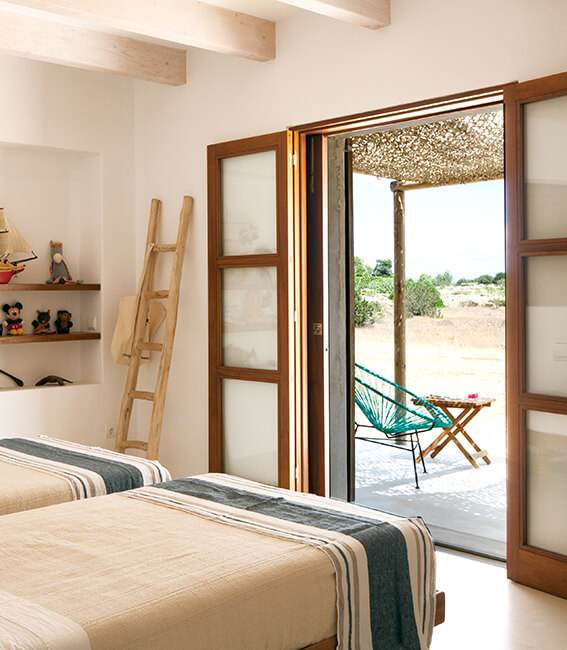 proyecto de interiorísmo Catalina House para casa Pep Lluqui. Decoración doritorios
